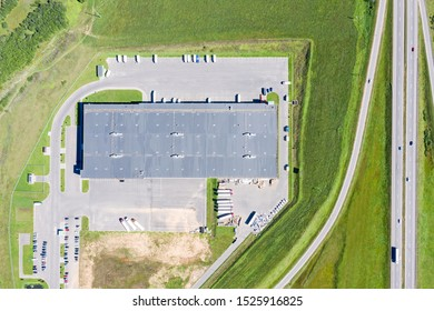 drone image of industrial warehouse with lots of trucks. birds eyes view