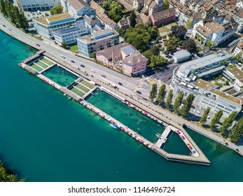 Drone image of the public swimming pool in the nature water on the Rhine river by the old Swiss town Schaffhausen, Switzerland