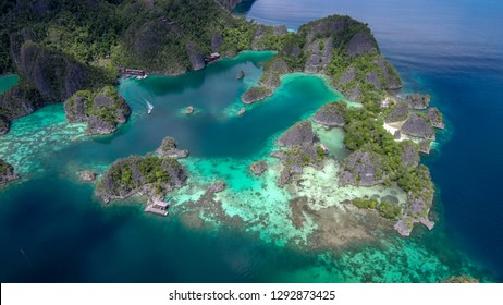 The drone looks at the Fam Islands from 500 meters high. Raja Ampat (Indonesia)