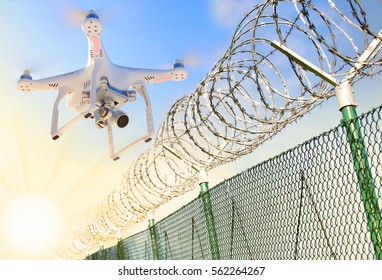 Drone monitoring barbed wire fence on state border or restricted area. Modern technology for security. Digital artwork on industrial theme.