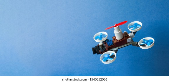 Drone multi copter sport competition. Advertising poster template with toy copter camera on blue background. Creative design aerial robotic rotorcraft mechanism 5 propellers, copy space