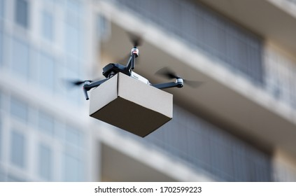 Drone is new tool for delivery, fast and safety air delivery. blurred building on background, copy space