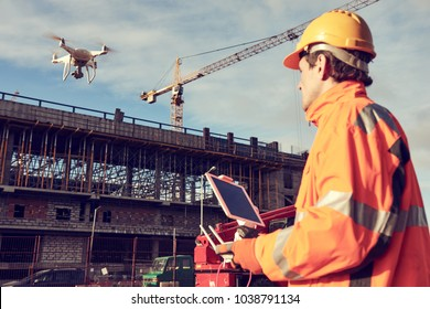Drone operated by construction worker on building site