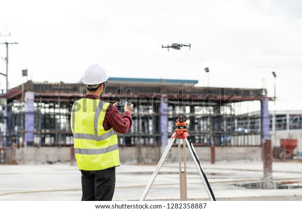 Drone Operated By Construction Worker On Stock Photo (Edit