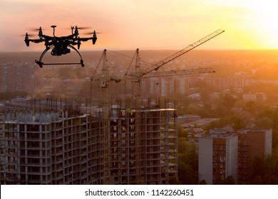 Drone over building construction.