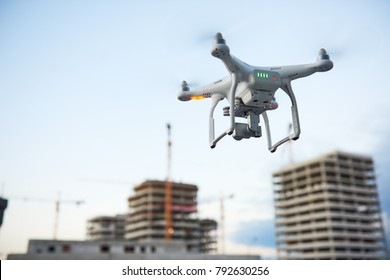 Drone over construction site. video surveillance or industrial inspection