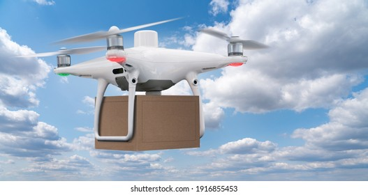 Drone with a package flying in the sky.  Unmanned delivery concept