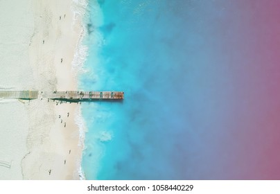 Drone panorama of pier in Grace Bay, Providenciales, Turks and Caicos with colored light leak