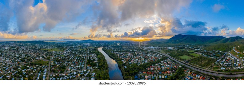 Drone panorama of Townsville, North Queensland, Australia, with Ross River cutting through middle of the shot