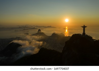 Drone, panoramic shot of a sunrise over Guanabara Bay with Christ the Redeemer statue in the foreground
