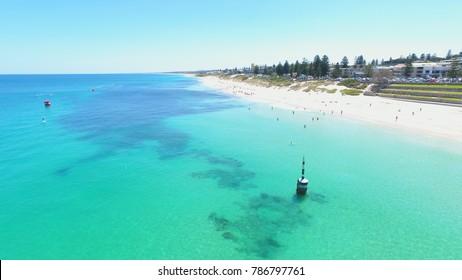Drone photo of bright blue ocean at Cottesloe Beach, Perth, Western Australia