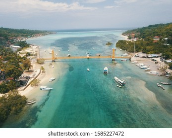 Drone photo of the yellow bridge linking Nusa Lembongan Island and Nusa Ceningan Island near Bali Indonesia