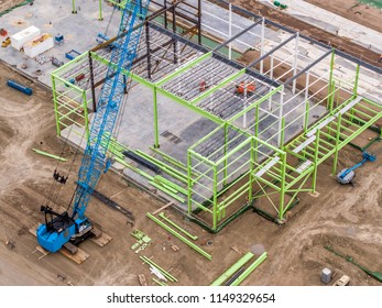Drone Point of View Construction Site of Steel Frame Building with Crane on Left Third