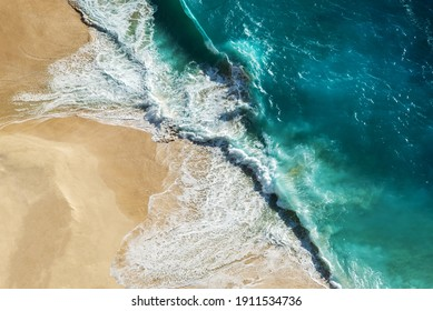 Drone point of view - Ocean waves at the with turquoise water