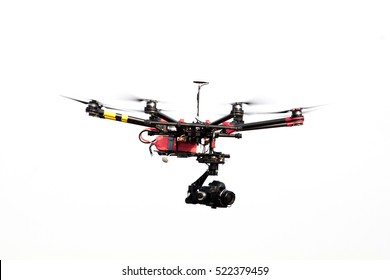 drone with professional camera flying.