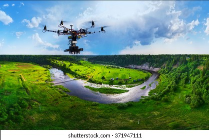 Drone with professional cinema camera flying over a summer park. Heavy lift drone photographing city at sunset.