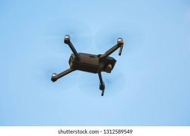 Drone quad copter with blue sky background