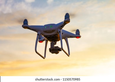 drone quad copter with digital camera at sunset ready to fly for surveillance.4 blade propeller drone. silhouette drone on sunset.