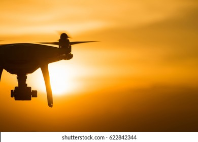 drone quad copter with digital camera at sunset ready to fly for surveillance. close-up of Rotor drones. 4 blade propeller drone. silhouette drone on sunset.