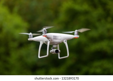 drone quad copter with high resolution digital camera against natural bokeh background