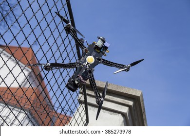 Drone quadcopter accident scene, UAV filming Quadrocopter crashed on fence in city park. space for text