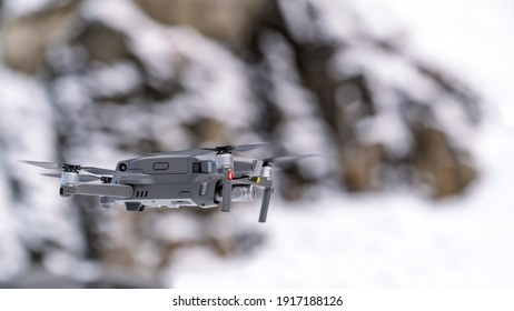 Drone quadcopter with digital camera in flight