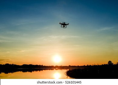 Drone quadcopter with digital camera in flight, Silhouette
