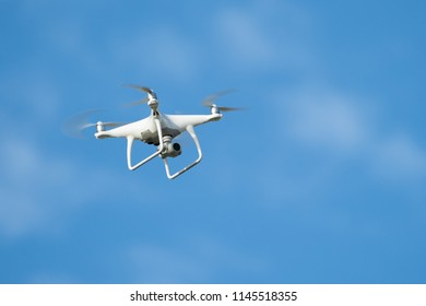 Drone quadcopter with digital camera, Drone hovering in blue sky