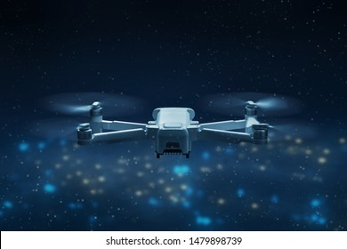 Drone quadcopter flying above city at night