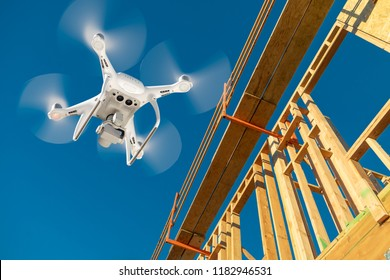 Drone Quadcopter Flying and Inspecting Construction Site.
