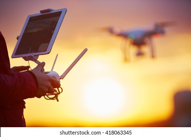 drone quadcopter flying at sunset