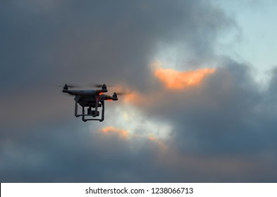 Drone quadrocopter Phantom 3 Professional with high resolution digital camera in dramatic winter sky at sunset time .November 20,2018,Kiev Region,Ukraine