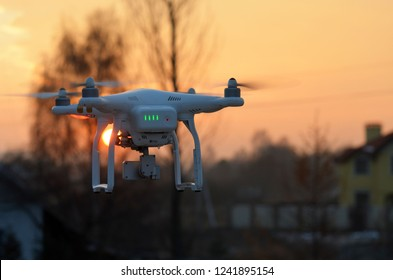 Drone quadrocopter Phantom 3 Professional with high resolution digital camera in dramatic sky at sunset time .November 24,2018,Kiev Region,Ukraine