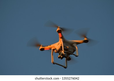 Drone quadrocopter Phantom 3 Professional with high resolution digital camera at sunset time. March 31, 2019, Kiev Region,Ukraine
