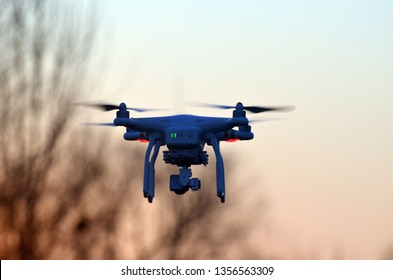 Drone quadrocopter Phantom 3 Professional with high resolution digital camera in dramatic sky at sunset time. March 31, 2019, Kiev Region,Ukraine