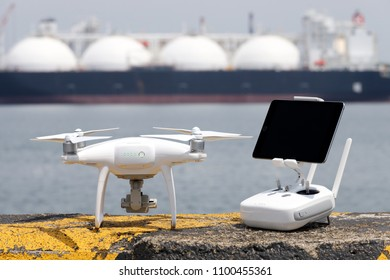 Drone with remote controller stay on concrete blocks for protection of port and ready to fly