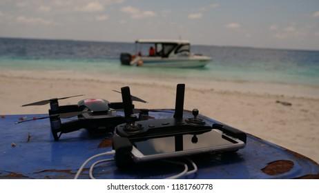 drone remote on beach island paradise maldives