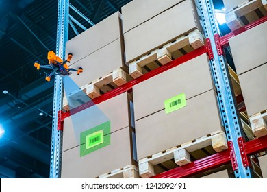 Drone scans barcode. Modern warehouse. Inventory in stock. Drone reads the barcode boxes in stock. Automation. Storage management. Responsible storage.