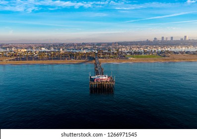 Drone shot from above of an ocean pier in Newport Beach, Orange County, California