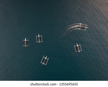 a drone shot of boats out in the ocean at Bali, Indonesia