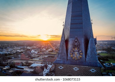 drone shot close up of a church tower clock at golden hour