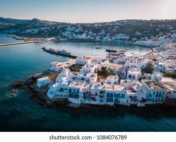 drone shot Famous Mykonos town windmills in a romantic sunset, Mykonos island, Cyclades, Greece, drone panorama