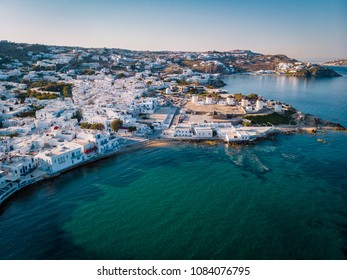 drone shot Famous Mykonos town windmills in a romantic sunset, Mykonos island, Cyclades, Greece, drone panorama