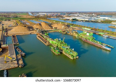 drone shot of heavy industry, with gravel dredging machinery.
