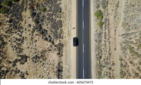 Drone shot of a land rover defender in the desert route 62