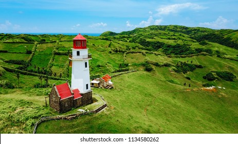 Drone shot of Mahatao Tayid Lighthouse on top rolling hills in the province of Batanes, Philippines