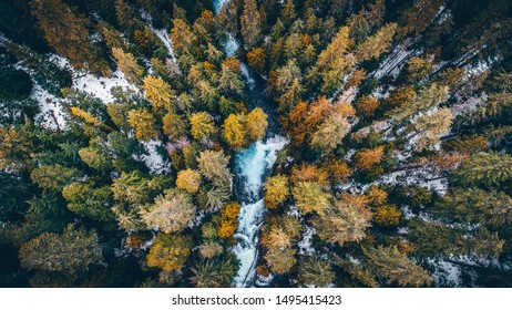 A drone shot of the snowy forest and the Mckenzie River at Sahalie Falls in Sisters, California