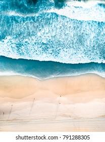 Drone shots of beautiful beaches in Australia with warm blue waters, swimmer and white sand. Burleigh Stradbroke Noosa Bondi