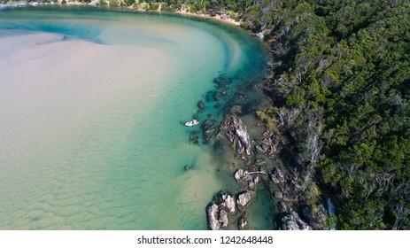 Drone shots of beautiful beaches and rocks in Australia with warm blue waters, swimmer, white sand and fisherman. Burleigh Stradbroke Noosa Bondi Coffs Harbour Ballina