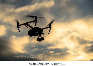 Drone silhouette flying in the evening sky